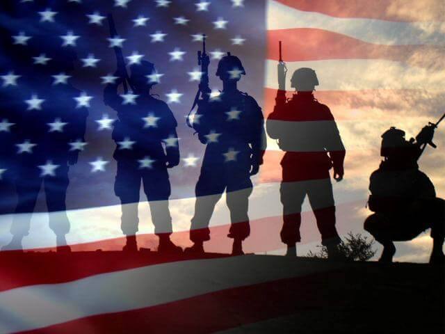 Silhouette of Soldiers behind the american flag
