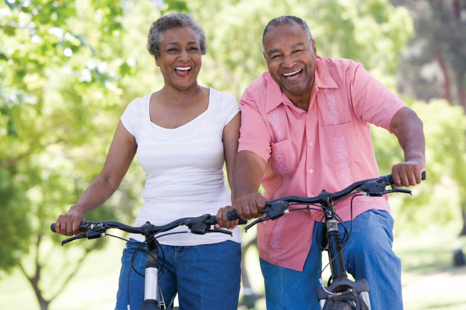 senior black couple on bicycles